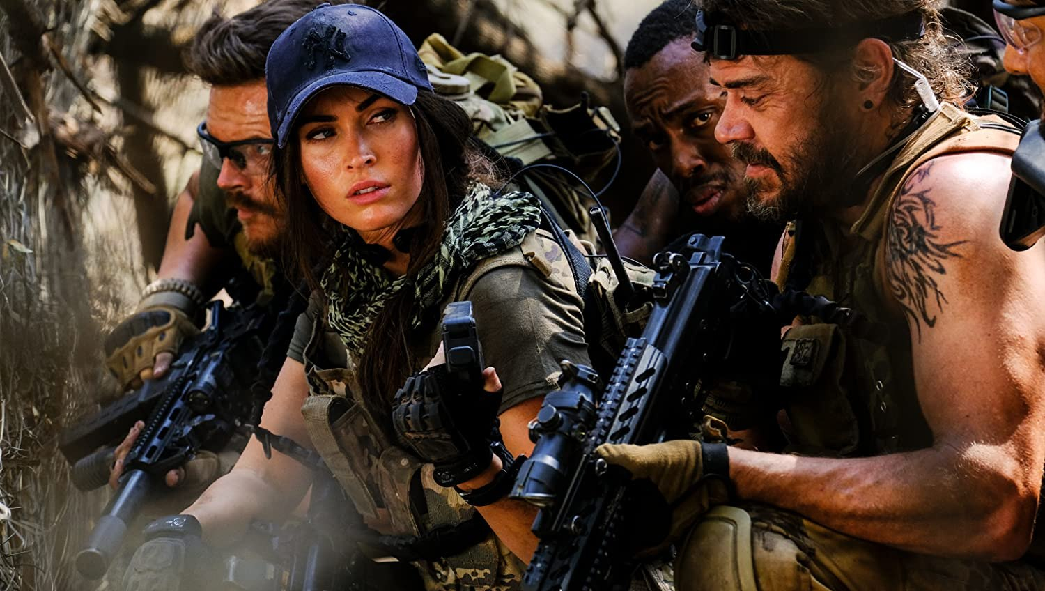 Megan Fox, Sisanda Henna, and Greg Kriek in Rogue (2020)